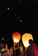 Mourners release lanterns during the community memorial vigil at Ben Lomond High School in Ogden for Emilie Parker, one of the children murdered during the recent school shooting at Sandy Hook Elementary, Thursday, Dec. 20, 2012