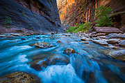 The Narrows in Zion National Park, (near Springdale, Utah) is a section of canyon on the North Fork of the Virgin River. The hike of The Narrows is one of the premier hikes on the Colorado Plateau. The term The Narrows refers to both the through-hike of The Narrows, and to The Narrows themselves, especially the 3.6 miles (5.8 km) long section of canyon between the end of the Riverside Walk Trail and Big Spring. The Narrows lies north of, and upstream of, the main Zion Canyon. Hiking the Narrows was rated # 5 in the National Geographic ranking of America's Best 100 Adventures
