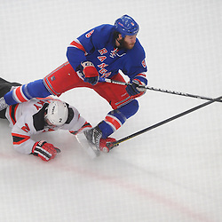 May 23, 2012: New York Rangers right wing Brandon Prust (8) shoots and scores as he is tripped by New Jersey Devils defenseman Marek Zidlicky (2) during first period action in game 5 of the NHL Eastern Conference Finals between the New Jersey Devils and New York Rangers at Madison Square Garden in New York, N.Y.