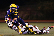Squally Canada (5) is tackled by a Fremont defender at Milpitas High School in Milpitas, California, on November 1, 2013. (Stan Olszewski/SOSKIphoto)