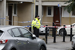 © Licensed to London News Pictures. 06/07/2021. London, UK. Crime screen cordons remain near Oval Place in south London where a 16 year old boy was stabbed to death last night. Police were called at around 23:45hrs on Monday, 5 July, to a teenager stabbed in Oval Place, SW8. Officers attended along with London Ambulance Service. The 16-year-old male was pronounced dead at the scene. Photo credit: Peter Macdiarmid/LNP