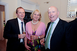 Left to right, JAMIE & CLAIRE WELLS and JULIAN FELLOWES at a reception to celebrate the repairs on the Queen Elizabeth Gate in Hyde Park after it's successful repair following damaged sustained in a traffic accident in early 2010.  The party was held at 35 Sloane Gardens, London on 7th June 2010.