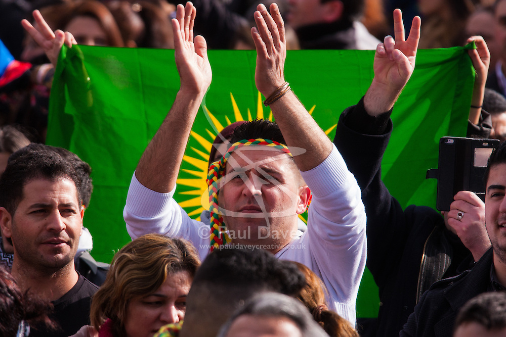 Finsbury Park, London, March 22 2015. Thousands of London's Kurdish community gather for Newroz, their traditional New year's celebrations. The exiled community mourns the death of Londoner and ex Royal Marine Konstandinos Erik Scurfield, a hero to them, who was killed fighting ISIS, and whose mother Vasiliki Scurfield addressed the crowd.