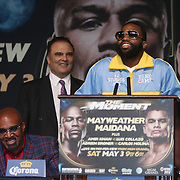 Boxer Adrien Broner speaks at the podium during the undercard final press conference for the Mayweather & Maidana boxing match at the Hollywood Theater, inside the MGM Grand hotel on Thursday, May 1, 2014 in Las Vegas, Nevada.  (AP Photo/Alex Menendez)