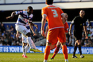 Queens Park Rangers Junior Hoilet shoots and scores his sides first goal of the game.  Skybet football league championship match , Queens Park Rangers v Blackpool at Loftus Road in London  on Saturday 29th March 2014.<br /> pic by John Fletcher, Andrew Orchard sports photography.