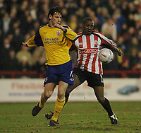 Photo. Leigh Quinnell, Digitalsport<br />   Brentford v Southampton FA cup. 01/03/2005. Brentfords Isaiah Rankin holds off a chaleenge from Southamptons Rory Delap