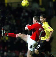 Fotball<br /> England 2004/2005<br /> Foto: SBI/Digitalsport<br /> NORWAY ONLY<br /> <br /> Watford v Rotheham United<br /> Coca-Cola Championship. 20/11/2004.<br /> <br /> Chris Swailes (Rotherham) deflects the ball from Scott Fitzgerald (Watford).