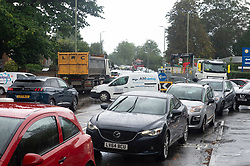 © Licensed to London News Pictures 28/09/2021.<br /> Mottingham, UK, Traffic queues around Mottingham BP petrol station. A tanker has just delivered fuel to Mottingham BP station in South East London. Within minutes of the tanker arriving motorists started to queue blocking roads. BP has started to ration petrol and diesel due to a shortage of truckers. Photo credit:Grant Falvey/LNP