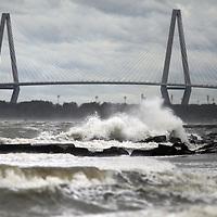 Waves crash near Sullivan's Island in front of the Ravenel Bridge on Saturday as Hurricane Matthew moved away. (ANDREW KNAPP/STAFF)