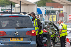 © Licensed to London News Pictures. 16/09/2020. London, UK. Cars queue to enter a covid-19 test centre at Twickenham this morning as test centre workers ask for a booking QR code. Twickenham test centre swung from being busy to quiet today as Covid-19 cases have continued to rise since August. Members of the public have found it increasingly difficult to book a space at a test centre with some people being told to drive 100s of miles to get an appointment. Health Minister Matt Hancock has said that the current testing crisis may last weeks. Photo credit: Alex Lentati/LNP