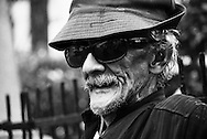 Old man with sunglasses sitting on a bench in Casco Viejo Panama.