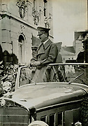 Adolf Hitler driven through a German city in an open Mercedes  c1936.
