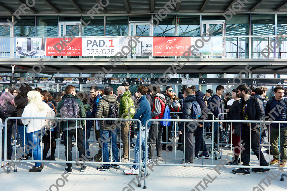 Milan, Italy - March 8 2019 Cartoomics Comic Con visitors line for buying tickets
