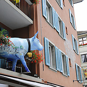 Cow on a balcony of a restaurant, a symbol of restaurant, in Zurich, Switzerland
