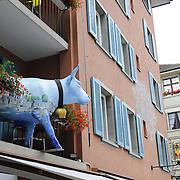 Cow on a balcony of a restaurant, a symbol of restaurant, in Zurich, Switzerland