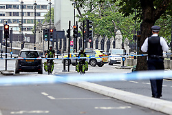 Police activity on Westminster Bridge, central London, after a car crashed into security barriers outside the Houses of Parliament.
