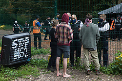 Metropolitan Police officers speak to HS2 Rebellion activists from within a compound used to fell trees as part of works connected to the HS2 high-speed rail link in Denham Country Park on 7 September 2020 in Denham, United Kingdom. Anti-HS2 activists continue to try to prevent or delay works on the controversial £106bn project for which the construction phase was announced on 4th September from a series of protection camps based along the route of the line between London and Birmingham.