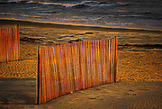 Fences at Misquamicut Beach in Rhode island at sunset.