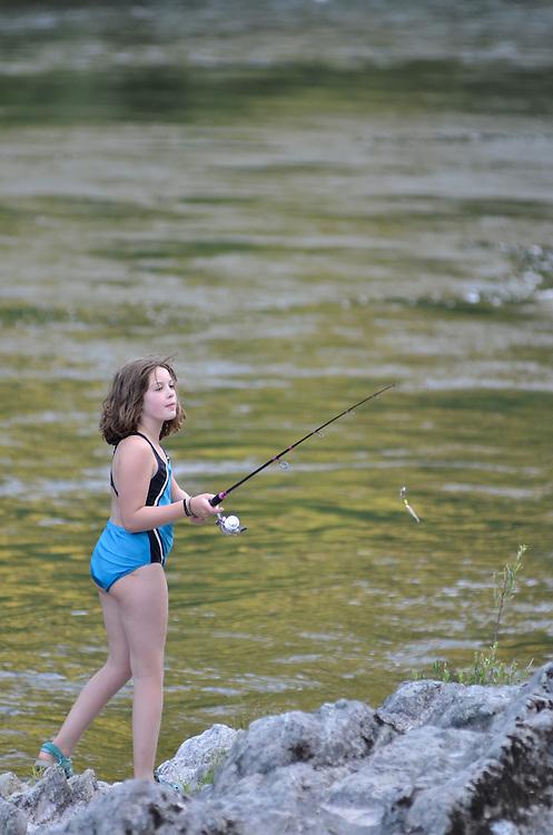 Girl fishing on Oregon's Rogue River.