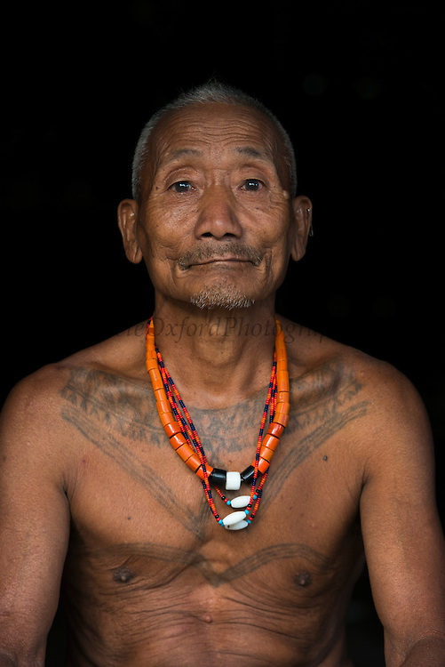Konyak Naga tattooed head hunter<br /> Only someone who and killed and taken a human head can be tattooed in this manner<br /> Konyak Naga headhunting Tribe<br /> Mon district<br /> Nagaland,  ne India