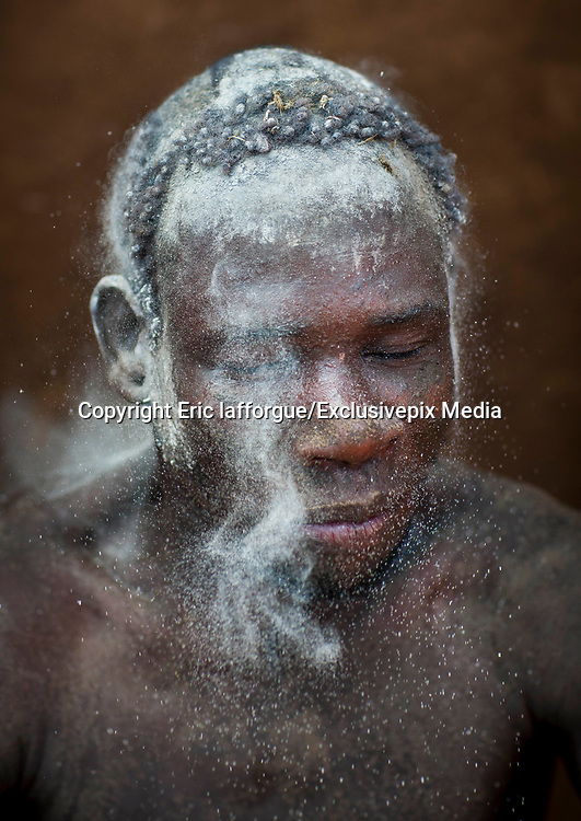 BODI TRIBE FAT MEN<br /> (very) big is beautiful<br /> <br /> Every  year,  takes  place  in the deep south of Ethiopia, in  the <br /> remote  area of Omo valley, the celebration of  the  Bodi  tribe  new <br /> year: the Kael.For  6  months  the  men  from  the tribe will   feed   themselves with only fresh  milk  and  blood  from <br /> the cows. They will not  be allowed to  have sex and to go out of their  little hut.  Everybody will take care of  them, the  girls  bringing  milk  every morning in pots or bamboos. The  winner  is  the  bigger.  He  just <br /> wins fame, nothing special. This  area does not  welcome tourists and has kept his traditions<br /> <br /> Photo shows: On  the  day  of  the  Kael, the  fat  men  cover  their <br /> bodies with clay and ashes.<br /> ©Eric lafforgue/Exclusivepix Media
