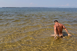 naked man in the Long Island Sound