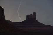 Lightning strike and butte at night in the Monument Valley, Navajo Tribal Park, Utah