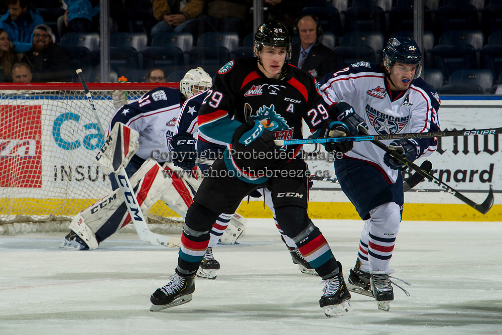 KELOWNA, CANADA - DECEMBER 5:  Nolan Foote #29 of the Kelowna Rockets stick checks Parker AuCoin #32 of the Tri-City Americans on December 5, 2018 at Prospera Place in Kelowna, British Columbia, Canada.  (Photo by Marissa Baecker/Shoot the Breeze)