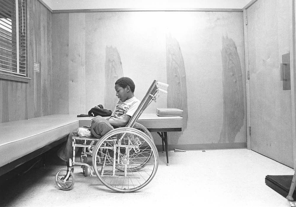 ©1984 4th grade boy Patrick Skeaton of Austin, Texas who had spina bifida and had to have a leg amputated while in 3rd grade. Photo story shows him during a typical day at school and at home with his mother Pat.