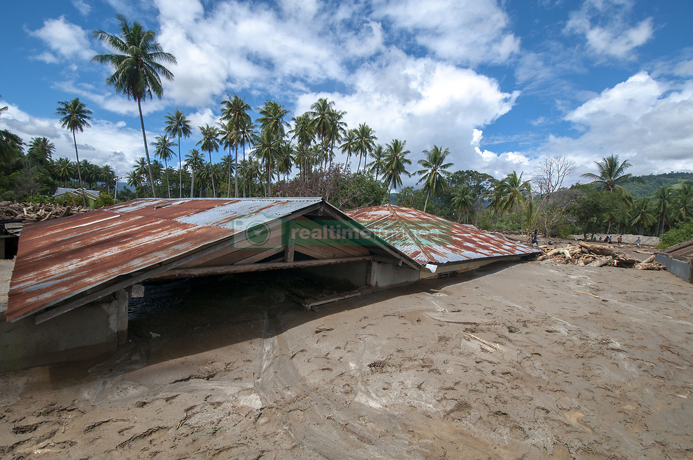 April 29, 2019 - Sigi, Central Sulawesi, Indonesia - SIGI, CENTRAL SULAWESI, INDONESIA - APRIL 29 : A resident was near his house which was buried in mud in a flash flood in Bangga Village, South Dolo Subdistrict, Sigi Regency, about 70 kilometers south of Palu City, Central Sulawesi Province, Indonesia on Monday ( April 29, 2019). The disaster that occurred on Sunday (April 28, 2019) at around 19:00 local time hoarded hundreds of houses, houses of worship, and schools in two villages, namely the Bangga and Balongga Village. (Credit Image: © Sijori Images via ZUMA Wire)