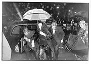 Arriving at the premiere in the rain, Leceister Square. 1996© Copyright Photograph by Dafydd Jones 66 Stockwell Park Rd. London SW9 0DA Tel 020 7733 0108 www.dafjones.com