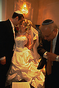 Jewish wedding in New Jersey, USA. The rabbi signs the wedding certificate before accompanying the couple to an outdoor canopy where he will marry them.