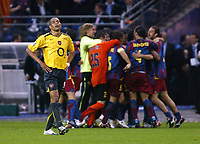 Photo: Chris Ratcliffe.<br /> Arsenal v Barcelona. UEFA Champions League Final. 17/05/2006.<br /> Gilberto is gutted as Barcelona celebrate behind him.