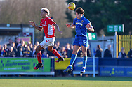 AFC Wimbledon defender Will Nightingale (5) beating Charlton Athletic attacker Lyle Taylor (9) to a header during the EFL Sky Bet League 1 match between AFC Wimbledon and Charlton Athletic at the Cherry Red Records Stadium, Kingston, England on 23 February 2019.