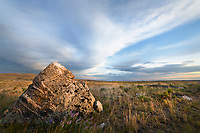 Granite boulder in prairie grasslands near Soda Lake. Sublette County Wyoming