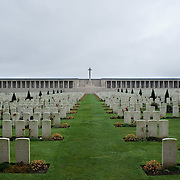 """The Pozières British Cemetery is enclosed by the Pozières Memorial to the Missing. The cemetery contains the original burials of 1916, 1917 and 1918 carried out by fighting units. There are in total 2,760 Commonwealth servicemen buried here. The memorial  commemorates over 14,000 casualties of the British Army that died on the Somme at the time of the German """"Spring Offensive""""  between March and August 1918 and have no known grave. The cemetery and memorial were designed by William Harrison Cowlishaw and it was unveiled in August 1930"""