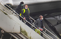 © Licensed to London News Pictures. 31/01/2020. Brize Norton, UK. Passengers disembark from a charter plane at RAF Brize Norton after being evacuated from Wuhan, China. The flight, carrying 83 Britons and 27 foreign nationals from the centre of the coronavirus outbreak, was initially delayed because of a lack of clearance by Chinese Authorities. The British passengers will travel by coach to a hospital in the north west of England for 14 days quarantine. Photo credit: Peter Macdiarmid/LNP