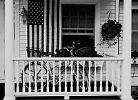 Flowers, flag, bicycle, white washed paint... Everything you need on Mackinac Island, MI.