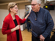 15 DECEMBER 2019 - WASHINGTON, IOWA: US Senator ELIZABETH WARREN (D-MA) talks to an elderly voter after her speech to a crowd of about 200 during a campaign event at Washington Middle School Sunday. Warren is campaigning in southeastern Iowa this weekend to support her effort to be the Democratic nominee for the US presidential race in 2020. This was Warren's 182nd town hall, and 85th event in Iowa. Iowa traditionally hosts the first presidential selection event of the campaign season. The Iowa caucuses are Feb. 3, 2020.      PHOTO BY JACK KURTZ
