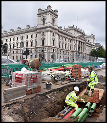 June 28, 2017 - London, London, United Kingdom - Image ©Licensed to i-Images Picture Agency. 28/06/2017. London, United Kingdom. Pipe repair Westminster. Construction workers repair pipes under the road surface outside the entrance to the House of Commons, in Parliament Square, Westminster, central London. Picture by Andrew Parsons / i-Images (Credit Image: © Andrew Parsons/i-Images via ZUMA Press)