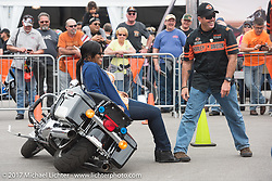 Rob Grimsley, a Harley-Davidson Regional Police Rep, explains how to pick up a bike with very little effort to Terra Green, New Orleans, LA at the Harley-Davidson Display during Daytona Bike Week. Daytona Beach, FL. USA. Monday March 13, 2017. Photography ©2017 Michael Lichter., explains how to pick up a bike with very little effort to Terra Green, New Orleans, LA at the Harley-Davidson Display during Daytona Bike Week. Daytona Beach, FL. USA. Monday March 13, 2017. Photography ©2017 Michael Lichter., explains how to pick up a bike with very little effort to Terra Green, New Orleans, LA at the Harley-Davidson Display during Daytona Bike Week. Daytona Beach, FL. USA. Monday March 13, 2017. Photography ©2017 Michael Lichter.