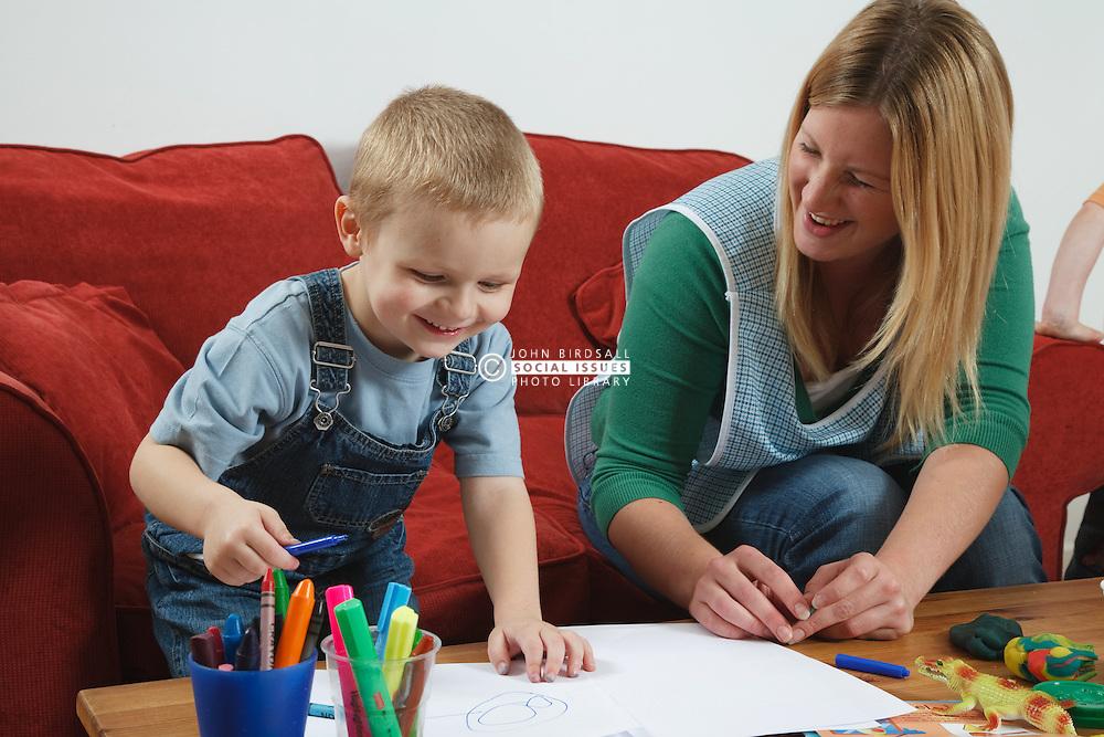 Nursery nurse playing with boy