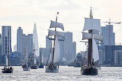 © Licensed to London News Pictures. 16/04/2017. London, UK. (C and R) TS JR Tolkein and TS Hendrika Bartelds pass by.  More than 30 ships from around the world take part in the Parade of Sail, the culmination of the Royal Greenwich Tall Ships Festival 2017.  Greenwich also marks the start of the Rendez-Vous 2017 Tall Ships Regatta, where these ships will journey to Quebec to mark the 150th anniversary of the Canadian Confederation. Photo credit : Stephen Chung/LNP