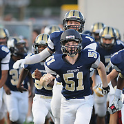 North Brunswick players enter the field before the third game of the 28th Annual BB&T Football Jamboree Friday August 15, 2014 at Legion Stadium in Wilmington, N.C. (Jason A. Frizzelle)
