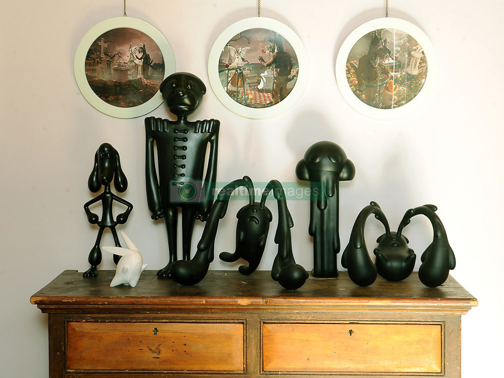 Cape Town - 180709 - Star Homes - 3 Regeant Road, Woodstock. He is a world renowned bronze sculptor and lives in Woodstock. Ferd Dick  is a world renowned bronze sculptor and lives in Woodstock. In pic are Dick's skulptures placed on top of a cupboard which is a family heirloom.  photographer - Tracey Adams/African News
