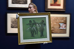 """© Licensed to London News Pictures. 06/10/2017. London, UK. A technician carries """"Trois Danseuses"""", 1889, by Edgar Degas at a preview at Sotheby's in New Bond Street of contemporary, impressionist and modern art works to be auctioned in New York in November 2017 Photo credit : Stephen Chung/LNP"""