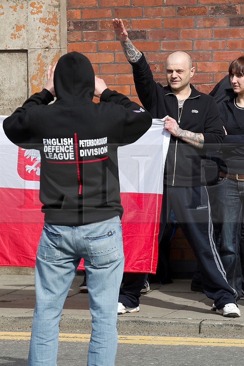 """© under license to London News Pictures. 02/04/2011: An EDL supporter poses for pictures and gives a Nazi salute after a rally in Blackburn. Credit should read """"Joel Goodman/London News Pictures""""."""