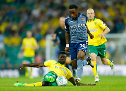 Charlton Athletic's Tariqe Fosu and Norwich City's Alex Tettey battle for the ball