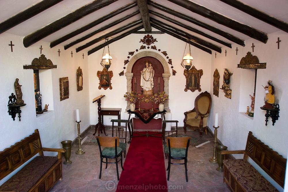 Private chapel interior of Pablo Corral Vega's farm house two hours outside Quito, Ecuador.