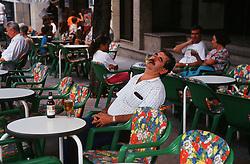 Man sleeping in café,